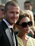 Дэвид и Виктория Бэкхэм в Лос-Анджелесе, 16 июля 2008 года. У звездной пары Дэвида и Виктории Бекхэм родилась в воскресенье дочь, ставшая четвертым ребенком в их семье. REUTERS/Danny Moloshok