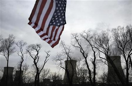 A U.S. flag flies near the cooling towers of the Three Mile Island nuclear power plant, where the U.S. suffered its most serious nuclear accident in 1979, in Middletown, Pennsylvania March 15, 2011. REUTERS/Jonathan Ernst