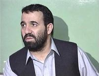 Ахмад Вали Карзай на пресс-конференции в Кветте (Пакистан), декабрь 2001 года.   Ахмад Вали Карзай, брат президента Афганистана Хамида Карзая и один из наиболее влиятельных людей в южной части страны, был убит во вторник, сообщили власти и члены семьи убитого. REUTERS/Reuters TV/Files