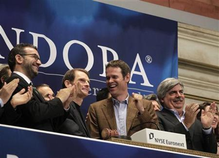 Joe Kennedy (2nd L), president and CEO, and Tim Westergren (2nd R), founder and Chief Strategy Officer of Pandora Internet radio, ring the opening bell at the New York Stock Exchange June 15, 2011. REUTERS/Brendan McDermid