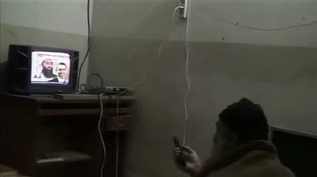 Osama bin Laden is shown watching himself on television, with U.S. President Barack Obama also on screen, in this video frame grab released by the U.S. Pentagon May 7, 2011. REUTERS/Pentagon/Handout/Files