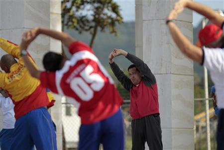 Venezuelan President Hugo Chavez stretches during his daily exercise routine in Caracas, July 11, 2011. REUTERS/Miraflores Palace