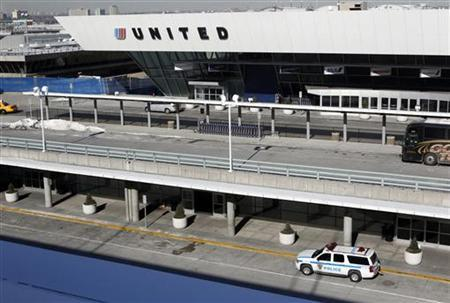 A police vehicle is parked outside a United Airlines terminal at John F. Kennedy International Airport in New York January 24, 2011. REUTERS/Jessica Rinaldi