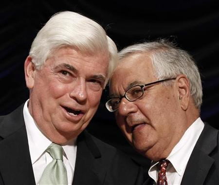 Co-sponsors of the Dodd-Frank Wall Street Reform and Consumer Protection Act, Sen. Christopher Dodd (L) and Rep. Barney Frank, wait for President Barack Obama to sign it into law at the Ronald Reagan Building in Washington, July 21, 2010. REUTERS/Larry Downing