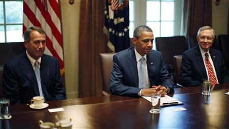 President Obama conducts a meeting with congressional leadership on deficit reduction in the Cabinet Room of the White House, July 13, 2011. Pictured with Obama are House Speaker John Boehner (L)(R-OH) and Senate Majority Leader Harry Reid (D-NV). REUTERS/Jason Reed