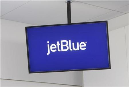 JetBlue Airways logo is displayed on a monitor in Terminal 5 at John F. Kennedy International Airport during a terminal test in New York August 23, 2008. REUTERS/Joshua Lott