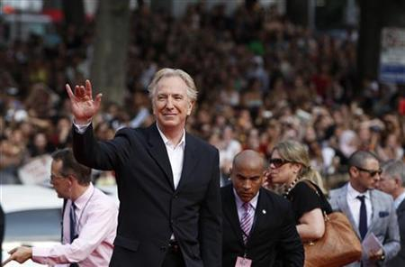 Cast member Alan Rickman waves as he arrives for the premiere of the film ''Harry Potter and the Deathly Hallows: Part 2'' in New York July 11, 2011. REUTERS/Lucas Jackson