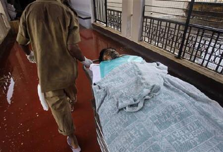 A man, injured by an explosion on Wednesday, is moved through the halls of a hospital to be treated for his burns in Mumbai July 14, 2011. REUTERS/Vivek Prakash