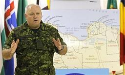 <p>Canadian Lieutenant General Charles Bouchard, commander of the NATO military operations in Libya, gestures during a media briefing at the NATO's Southern Europe headquarters in Naples April 26, 2011. REUTERS/CiroDe Luca</p>