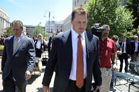 Former Major League Baseball pitcher Roger Clemens (front) leaves the federal courthouse in Washington July 14, 2011. REUTERS/Jonathan Ernst