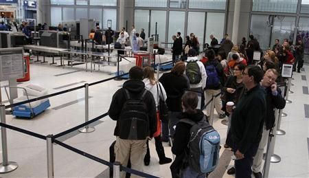 Passengers wait to pass through a Transportation Security Administration screening check-point at O'Hare International airport in Chicago November 24, 2010. REUTERS/Frank Polich