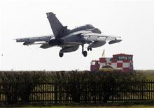 A British RAF Tornado lands at RAF Marham, southern England, March 20, 2011. REUTERS/Darren Staples