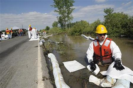 Andrew Cole of Yakima, Washington, on assignment for Exxon Mobil cleans up oil spill along the Yellowstone River in Laurel, Montana, July 6, 2011. REUTERS/John Warner