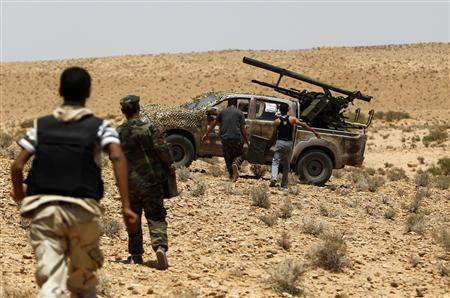Libyan rebels prepare to fire a rocket on the frontline south of the town of Bir Ghanam, July 16, 2011. REUTERS/Ammar Awad