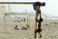 Libyan boys play on a beach in Benghazi June 26, 2011. REUTERS/Amr Abdallah Dalsh