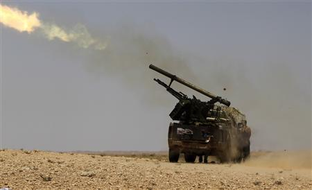 Libyan rebels fire a rocket on the frontline south of the town of Bir Ghanam, July 16, 2011. REUTERS/Ammar Awad