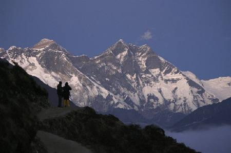 Travellers enjoy the the view of Mount Everest at Syangboche in Nepal December 3, 2009. REUTERS/Gopal Chitrakar/Files