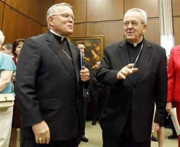 Archbishop Charles J. Chaput (L) stands with Cardinal Justin Rigali before a news conference announcing Rigali's retirement and the appointment of Chaput as his replacement at the Archdiocese of Philadelphia headquarters in Philadelphia, Pennsylvania, July 19, 2011. REUTERS/Tim Shaffer
