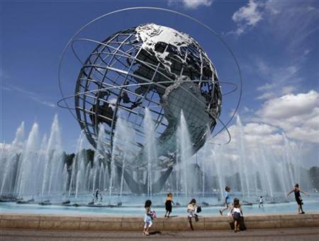 Children play around the Unisphere, the giant steel globe commissioned to celebrate the beginning of the space age, which was conceived and constructed as the Theme Symbol of the 1964/1965 New York World's Fair in Flushing Meadows-Corona Park in Queens, New York August 23, 2008. REUTERS/Jeff Haynes