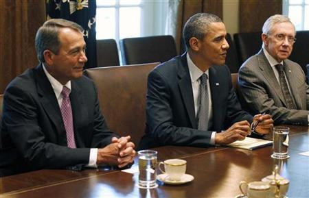 President Barack Obama (C) conducts a meeting with congressional leadership on deficit reduction in the Cabinet Room of the White House in Washington, July 14, 2011. Pictured with Obama are House Speaker John Boehner (R-OH) (L), and Senate Majority Leader Harry Reid (D-NV). REUTERS/Jason Reed