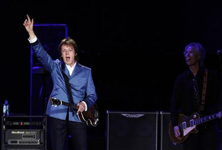 Paul McCartney performs during a concert at Yankee Stadium in New York July 15, 2011. REUTERS/Lucas Jackson
