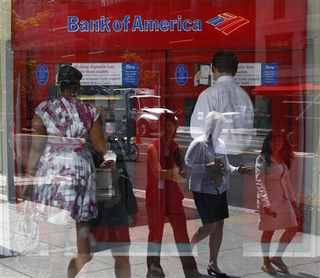 Pedestrians are reflected in the window as customers conduct transactions at a Bank of America ATM in Washington, July 19, 2011. REUTERS/Kevin Lamarque