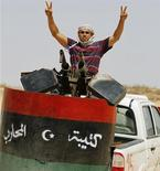 A Libyan rebel fighter flashes the victory sign at the Abdel Rauf frontline, south of Misrata July 19, 2011. REUTERS/Thaier al-Sudani