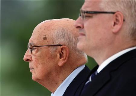 Italian President Giorgio Napolitano (L) and his Croatian counterpart Ivo Josipovic listen to their respective national anthems during their meeting in Zagreb July 14, 2011. REUTERS/Nikola Solic