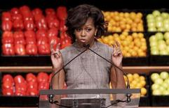 <p>First Lady Michelle Obama speaks at the Walmart announcement initiative to make food healthier and more affordable in Washington, January 20, 2011. REUTERS/Yuri Gripas</p>