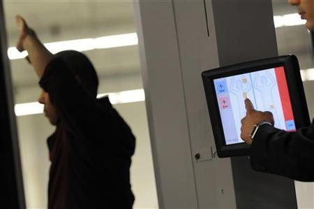 Transportation Security Administration employees show new body scanner software that uses a stick figure to represent the passenger being scanned, rather than an actual image of the person, at the TSA Systems Integration Facility at Washington's Reagan National Airport in Arlington, Virginia, February 1, 2011. REUTERS/Jonathan Ernst