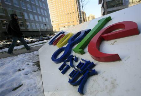 A man walks towards the Google China headquarters in Beijing January 13, 2010. Google has held preliminary talks about buying wireless developer InterDigital Inc, the Wall Street Journal said on Thursday. REUTERS/Jason Lee/Files