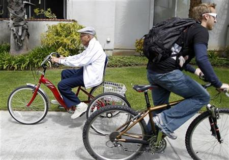 Octavio Orduno, 103, (L) goes for his daily cycle ride in Long Beach, California March 23, 2011. Orduno has been riding for 96 years. REUTERS/Lucy Nicholson