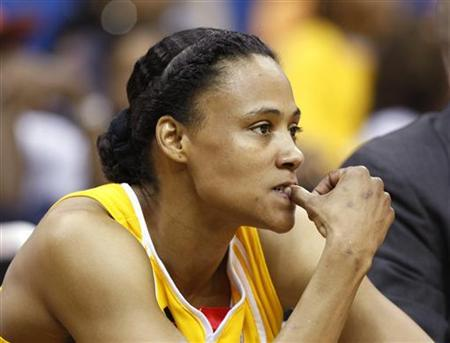 Tulsa Shock guard Marion Jones watches from the bench during first half action at their WNBA basketball game against the Minnesota Lynx in Tulsa, Oklahoma, May 15, 2010. REUTERS/Bill Waugh