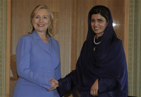U.S Secretary of State Hillary Clinton (L) shakes hands with Pakistani Minister of Foreign Affairs Hina Rabbani Khar during a bilateral meeting on the sidelines of the ASEAN Regional Forum (ARF) Meeting in Nusa Dua, Bali July 23, 2011. REUTERS/Murdani Usman