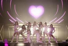 <p>South Korean pop group Girls' Generation perform during their concert at Olympic Gymnasium in Seoul, in this handout picture taken on July 23, 2011 and released to Reuters on July 24, 2011. Picture taken on July 23, 2011. REUTERS/S.M. Entertainment/Handout</p>