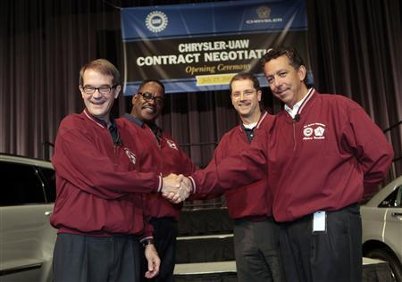 United Auto Workers President Bob King (L), Chrysler Group LLC Senior Vice President Manufacturing Scott Garberding (R), UAW Vice President, UAW Chrysler Department, General Holiefield (rear L) and Chrysler Group Vice President Employee Relations Al lacobelli attend the opening ceremonies of the Chrysler UAW Contract Negotiations at the Chrysler headquarters in Auburn Hills, Michigan, July 25, 2011. REUTERS/Rebecca Cook