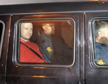 Norwegian Anders Behring Breivik (L), the man accused of a killing spree and bomb attack in Norway, sits in the rear of a vehicle as he is transported in a police convoy as he is leaving the courthouse in Oslo July 25, 2011.REUTERS/Jon-Are Berg-Jacobsen/Aftenposten via Scanpix