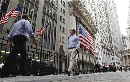Pedestrians walk past the outside of the New York Stock Exchange in New York July 25, 2011. REUTERS/Lucas Jackson