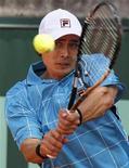 Игорь Куницын на турнире в Париже, 24 мая 2011 года. Российский теннисист Игорь Куницын вышел во второй круг турнира Los Angeles International, проходящего в США. REUTERS/Charles Platiau