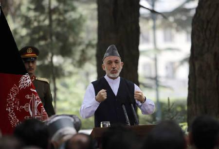 Afghanistan's President Hamid Karzai speaks during a gathering with military personnel at the presidential palace in Kabul July 26, 2011. REUTERS/Omar Sobhani
