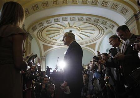 Senate Majority Leader Harry Reid speaks to the press following more U.S. debt reduction talks on Capitol Hill, July 26, 2011. REUTERS/Jason Reed