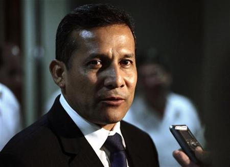 Peru's President-elect Ollanta Humala speaks to reporters at Havana's Jose Marti Airport July 19, 2011. Humala is on a one-day working visit to Cuba. REUTERS/Desmond Boylan