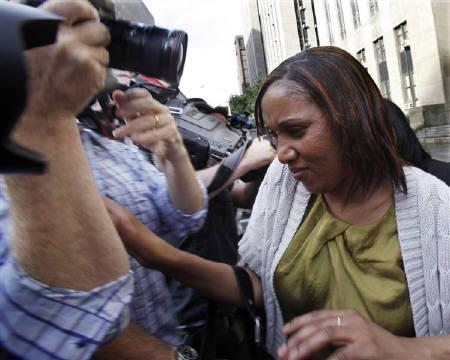 Nafissatou Diallo (C), the Manhattan maid who has accused Dominique Strauss-Kahn of sexually assaulting her, is escorted from Manhattan Criminal Court after meeting with her lawyers and the New York District Attorney in New York  July 27, 2011. REUTERS/Shannon Stapleton