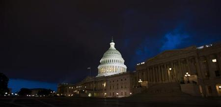 Storm clouds gather above the Capitol in Washington July 11, 2011. REUTERS/Jonathan Ernst