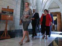 <p>New Democratic Party MP Nycole Turmel (L) arrives to speak to journalists following a caucus meeting on Parliament Hill in Ottawa July 27, 2011. REUTERS/Chris Wattie</p>