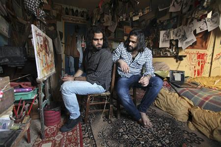 Palestinian filmmaker Ahmed Abu Naser, 23, and his twin and artistic partner Mohammed (R) sit in their studio at their family house in the northern Gaza Strip December 28, 2010. REUTERS/Mohammed Salem/Files