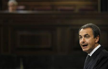 Spanish Prime Minister Jose Luis Rodriguez Zapatero speaks during an extraordinary plenary session at Parliament in Madrid July 27, 2011. REUTERS/Susana Vera
