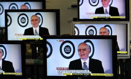 The Chairman, and Chief Executive of News Corporation, Rupert Murdoch is seen talking on Sky News on television screens in an electrical store in Edinburgh, March 3, 2011. REUTERS/David Moir
