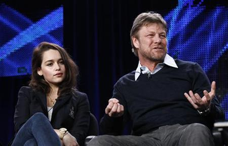 Cast member Sean Bean answers a question as co-star Emilia Clarke watches at the HBO panel for the television series ''Game of Thrones'' during the Television Critics Association winter press tour in Pasadena, January 7, 2011. REUTERS/Mario Anzuoni