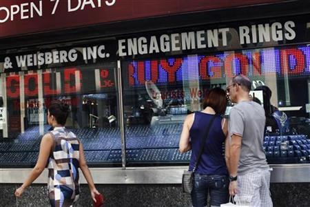 People shop outside a jewelry store in the diamond district of New York July 19, 2011. REUTERS/Shannon Stapleton